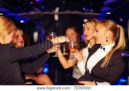 Beautiful Women Clinking Glasses In Limousine