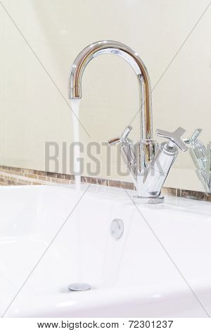 White Sink Washbasin And Silver Curve Design Faucet
