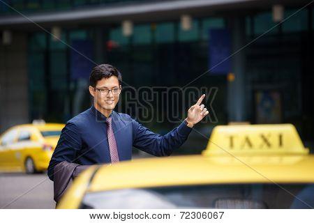 Asian Businessman Calling Taxi Car Leaving Work