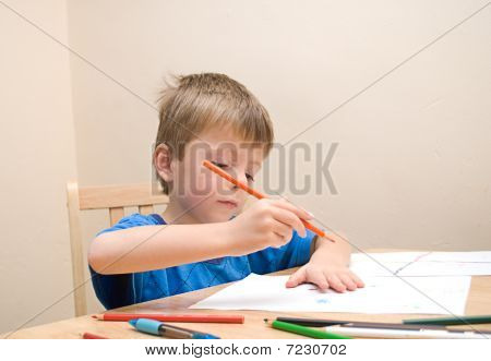 Child writing on paper.