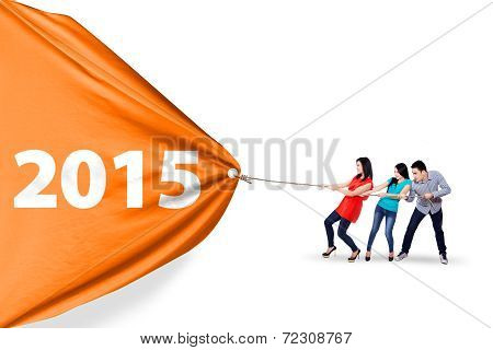 Happy People Pulling A Banner 2015