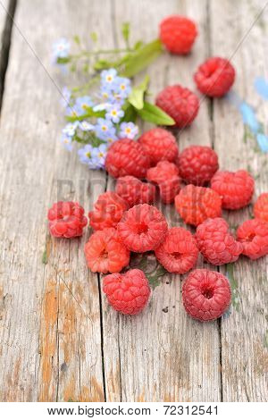 raspberries on wooden background