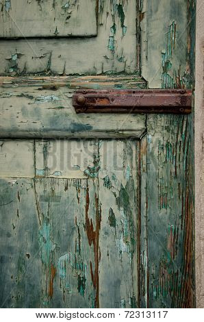 Detail Of Paint Pealing Of Weathered Wooden Door