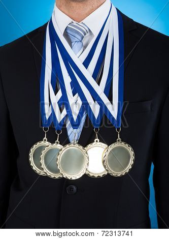 Midsection Of Businessman Wearing Medals