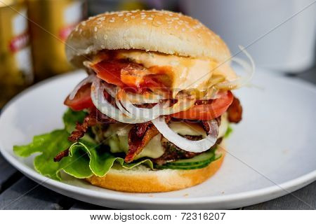 Grilled Hamburger With Bacon On A White Plate