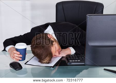 Overworked Businessman Resting On Contract Paper