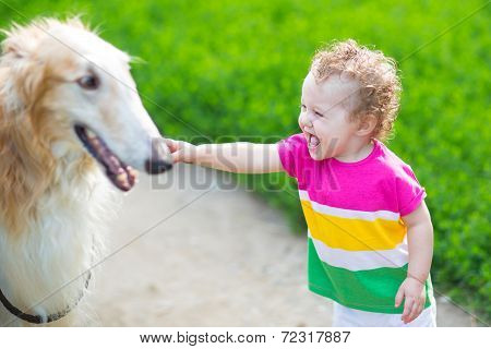 Happy Laughing Baby Playing With A Big Dog