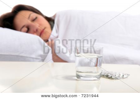 Young Woman Is Ill In Bed