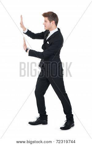Businessman Pushing Invisible Wall