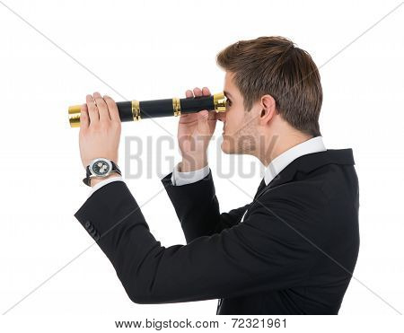 Young Businessman Looking Through Handheld Telescope