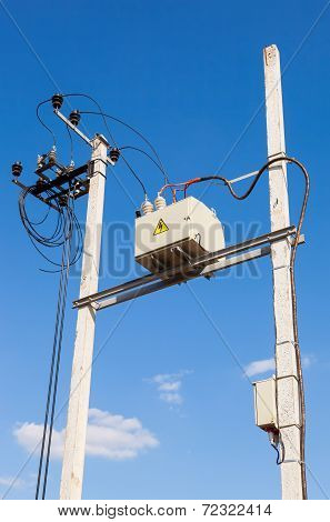 Transformer On High Power Station Against Blue Sky Background