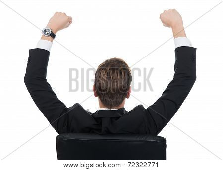 Successful Businessman Sitting On Chair