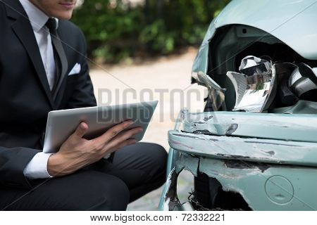 Closeup Of Agent Examining Car