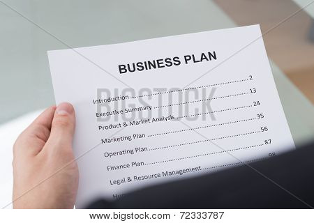 Businessman Reading Business Plan