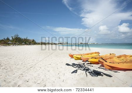 Kayaks on beach.