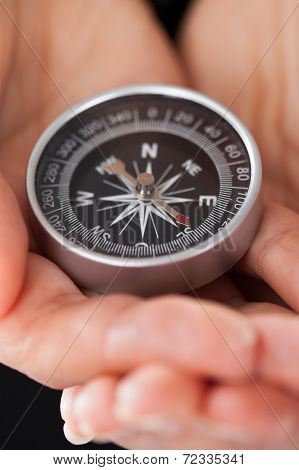Businessperson Holding Compass