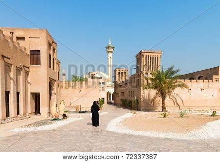 Muslim Woman In Old Arabic District With Mosque