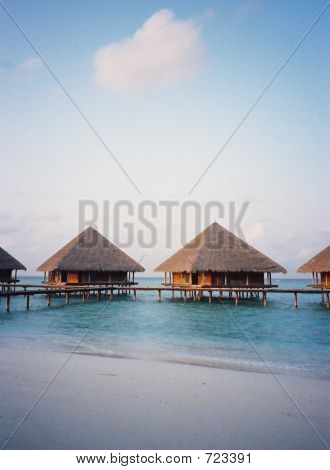 Huts On Stilts At Maldives