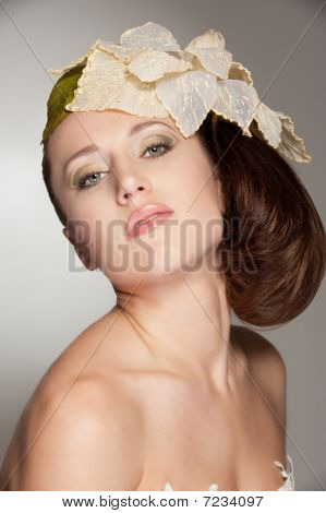 Stylish Woman With Big Flower On Her Head