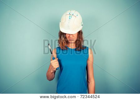 Young Female Builder Holding A Chisel