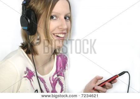 Girl With Cell Phone And Headphones