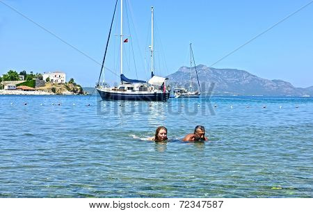 Couple swimming in sea