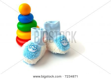 Children's toy a pyramid and blue bootees socks