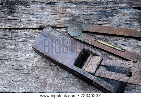 Old Vintage Hand Tools On Wood Background (plane And Gauge)