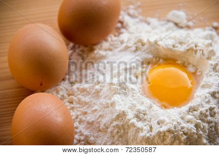 white flour and eggs on the table