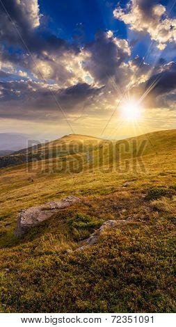 Stones On The Mountain Hillside At Sunset