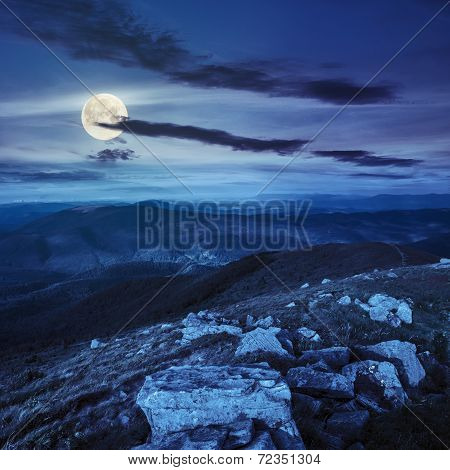 Stones On The Mountain Hillside At Night