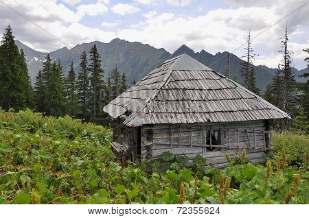 Old wooden hunter's hut in mountains