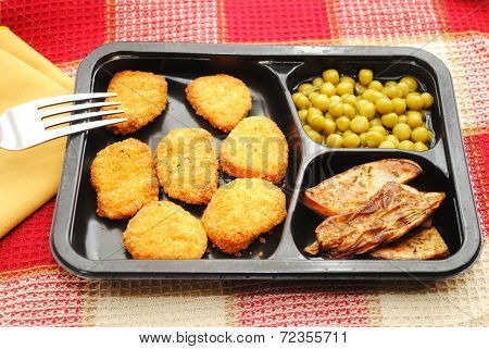 Chicken Or Fish Nugget Micowaved Dinner Served