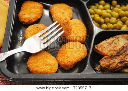 Close Up Of Chicken Or Fish Nuggets For Dinner