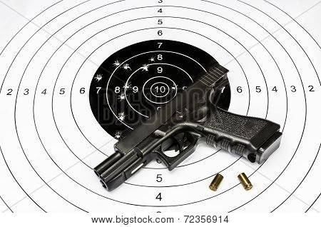 Gun And Shooting Target