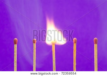 Burnning Match Setting On Purple Background For Ideas And Inspiration
