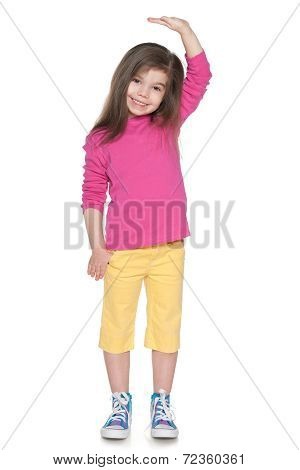 Smiling Little Girl Showing Her Height