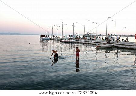 People enjoy their time around pier