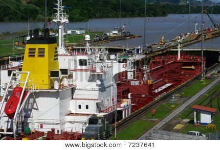 Boat Crossing The Locks Of The Panama Canal.
