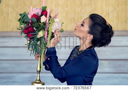 Beautiful Girl With Candelabra Decorated With Flowers