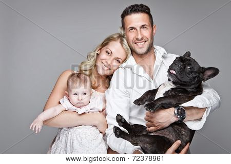 Beautiful Young Family With Little Baby