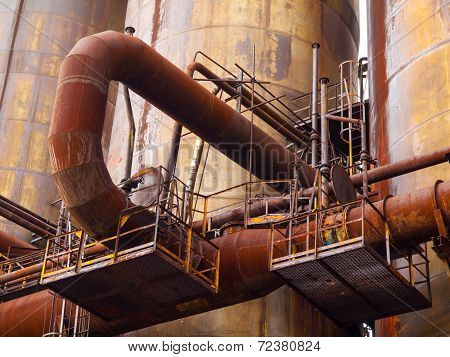 Rusty pipes in industrial factory