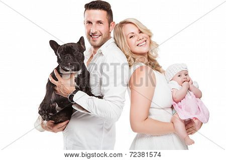 Beautiful Young Family With Little Baby And Dog