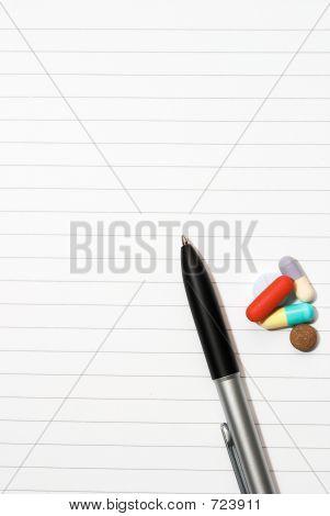 notepad, one pen, pills