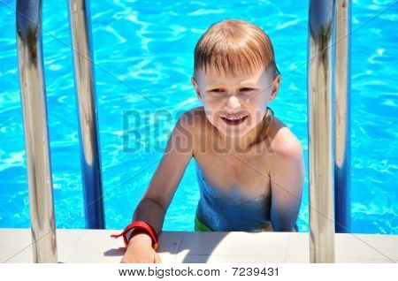 Little Boy In Swimming Pool