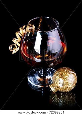 Glass With Drink And A Christmas Ball.