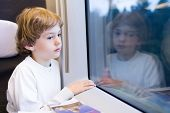 image of high-speed train  - Little Tired Boy In A High Speed Train - JPG