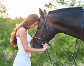 picture of beautiful horses  - Portrait beautiful woman with long hair next horse. Focus on the horse