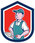 pic of mason  - Illustration of a bricklayer mason plasterer worker standing holding a trowel set inside shield crest on isolated background done in cartoon style - JPG