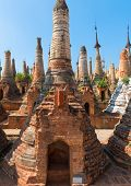 stock photo of shan  - Ruins of ancient Burmese Buddhist pagodas in the village of Indein on Inlay Lake in Shan State Myanmar  - JPG